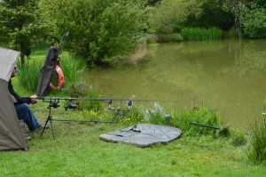 bivvy, rods in water