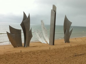 french monument to fallen allied forces on normandy beaches